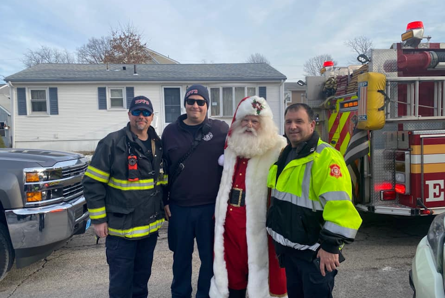 Santa Claus and Rhode Island First Responders delivering gifts to those in need.